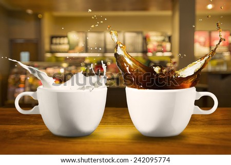 Coffee and Milk Splash from cup in Coffee Shop - stock photo