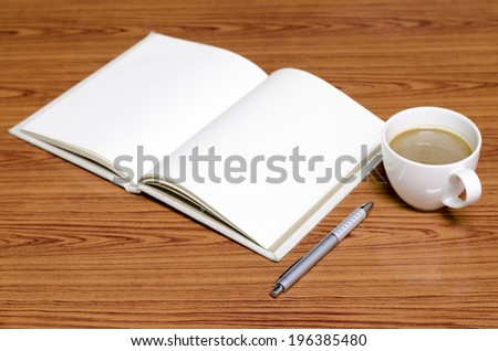 coffee and notebook on wood background concept coffee time