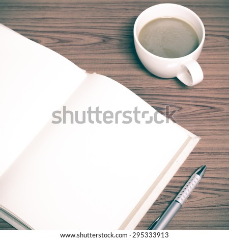 coffee and notebook on wood background concept coffee time vintage style