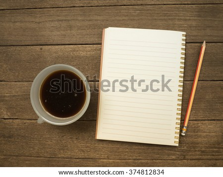 Coffee and notebook with pencil