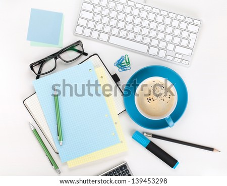 Coffee and office supplies. View from above. On white background