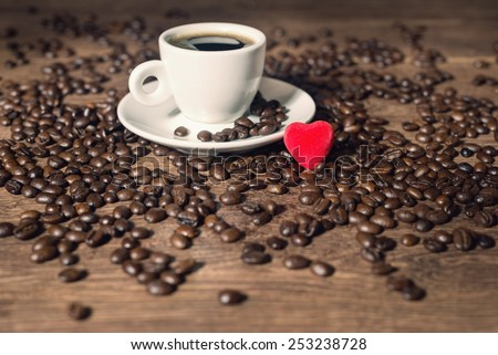 coffee and red heart on the wood table