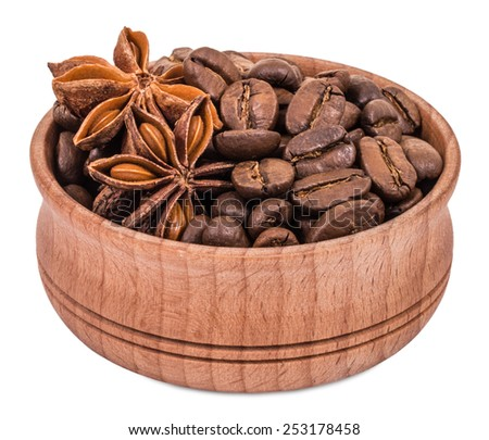Coffee and star anise in a wooden bowl isolated on white background - stock photo