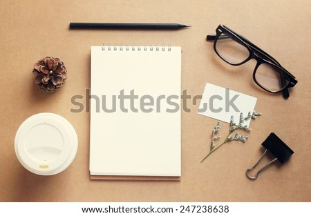 Coffee and stationery mockup set with retro filter effect - stock photo