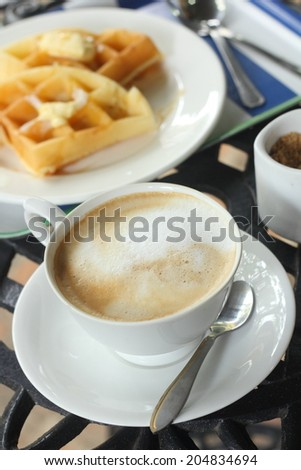 coffee and waffles with honey - stock photo