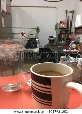 Coffee And Water Cups On A Vintage Diner Counter
