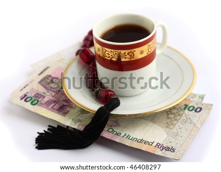 Coffee, Arabian high-value bank notes and worry beads - the essentials for doing business in the arab world - stock photo