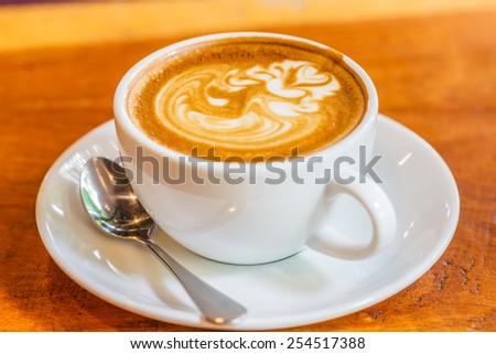 Coffee Art on Wooden Table - stock photo
