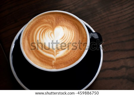 Coffee art with wooden background - stock photo