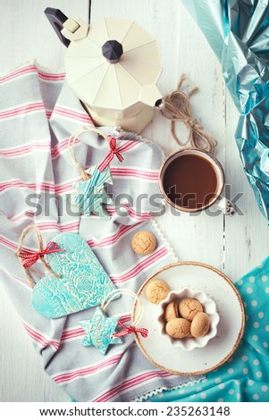 Coffee at Christmas morning: cup of espresso set with handmade ceramic decorations and italian coffeemaker - stock photo