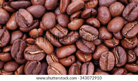 Coffee background. Macro coffee. Coffee beans. Medium roast coffee beans. Fragrant coffee. Selected coffee beans. Arabica, Robusta, grade coffee. Coffee shop. Bitter taste. Invigorating, caffeine. - stock photo