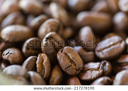 Coffee bean background with short Depth Of Field for focus - stock photo
