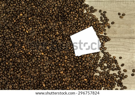 Coffee bean background with space for text on kitchen table - stock photo