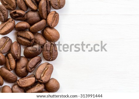 Coffee bean border on  painted wood surface  - stock photo