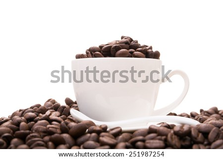 coffee bean in cup and coffee beans on white background - stock photo