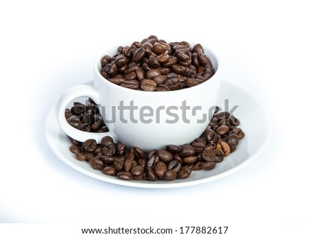 Coffee bean in white cup isolated
