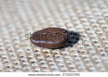 Coffee bean lying on jute fabric / Coffee bean - stock photo