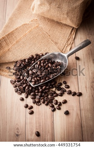 Coffee bean on grunge wooden background. Top view
