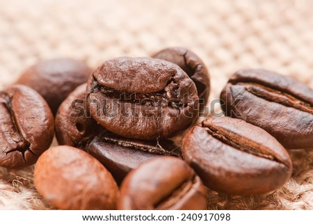 Coffee bean on jute sack background - stock photo