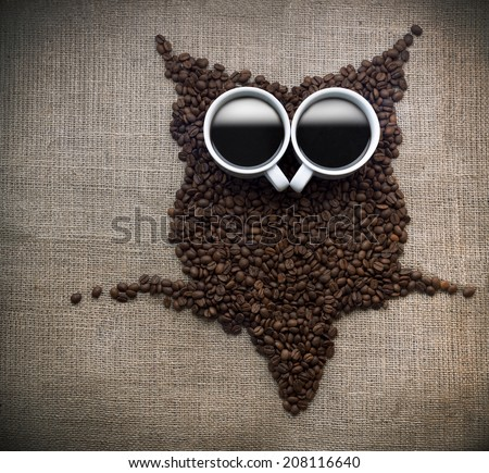 Coffee bean owl, Owl silhouette made with coffee beans on a coffee sack. - stock photo