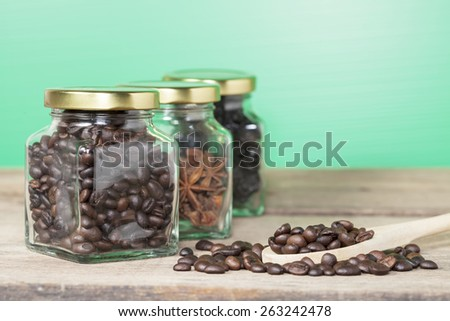 Coffee bean with view of the coffee jar and Heab jar  - stock photo