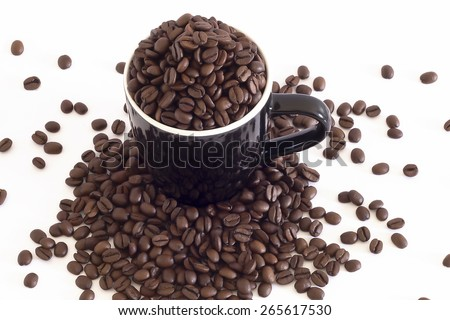 Coffee beans and a black mug, top view - stock photo