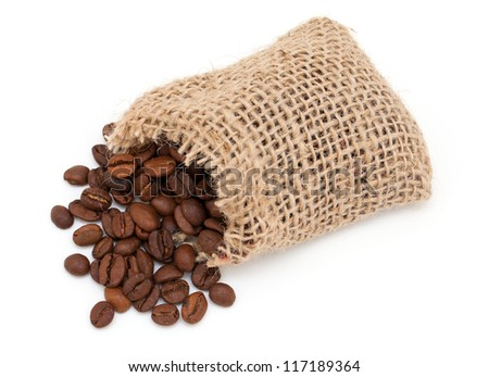 coffee beans and a miniature burlap sack - stock photo