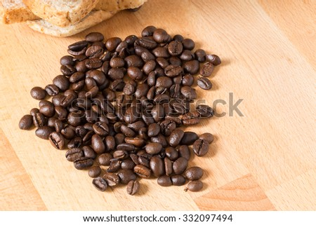 coffee beans and bread slices on wooden table  for background