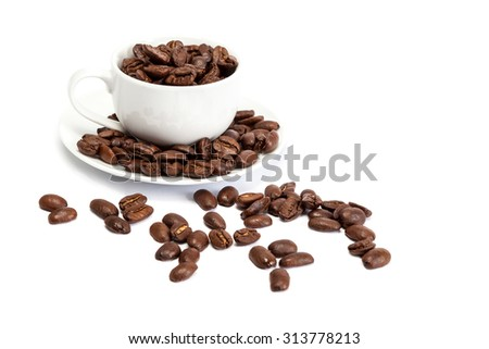 Coffee beans and ceramic cup isolated on white background.