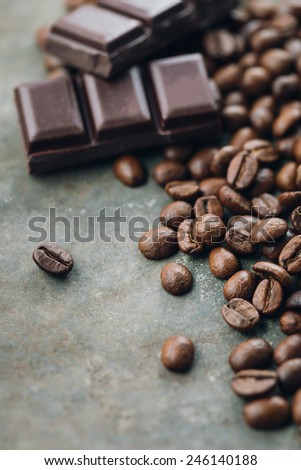 Coffee beans and chocolate - stock photo