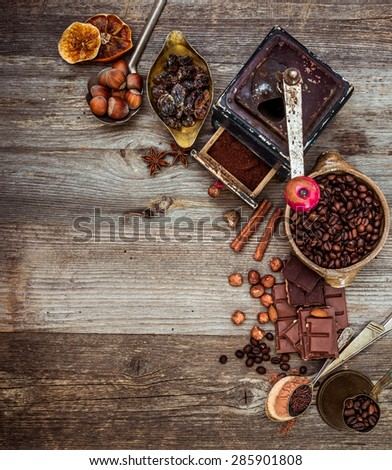coffee beans and chocolate on a wooden background.  top view - stock photo