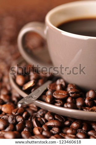 Coffee beans and coffee cup - stock photo