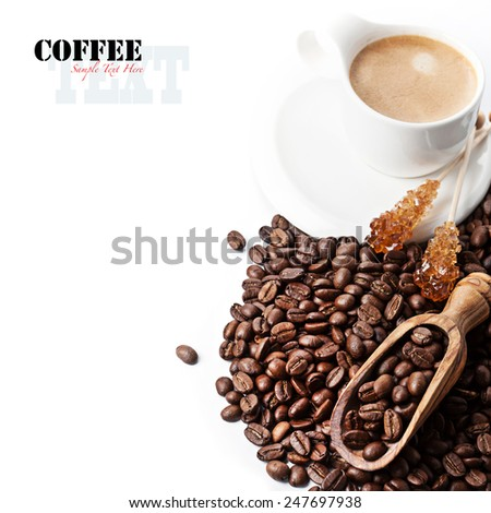 Coffee beans and cup of coffee isolated on white