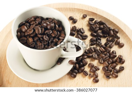 Coffee beans and cup on wooden tray, isolated on white background.