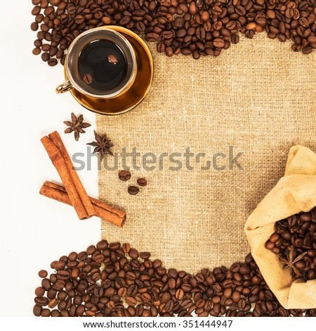 Coffee beans and golden cup with bag on natural background wicker top