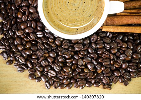 Coffee beans and hot coffee cup
