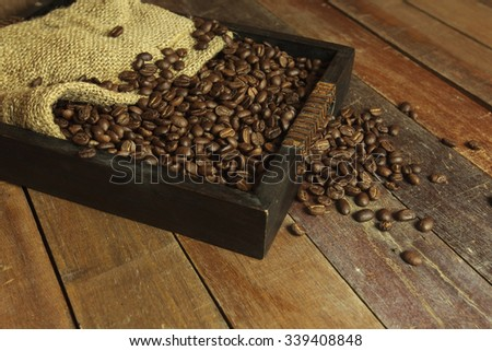 Coffee Beans and sack still life. - stock photo
