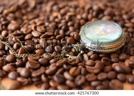 Coffee beans and watches - stock photo