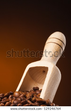 coffee beans and wooden scoop - stock photo