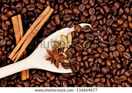 Coffee beans and wooden spoon with spice