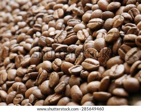 Coffee beans arabica type shallow DOF background - Roasted arabica coffee beans shallow DOF background - stock photo