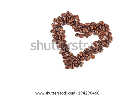 Coffee beans arranged in a heart shape. - stock photo