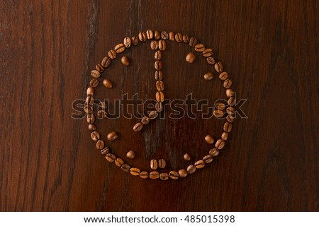Coffee beans arranged into a clock.