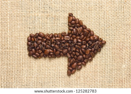 coffee beans arrow on sacking background