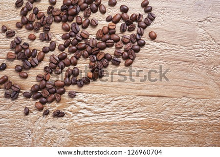 coffee beans as background  on the old wooden table - stock photo