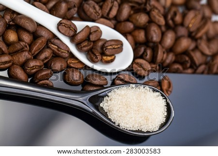 Coffee beans, brown sugar and small teaspoons