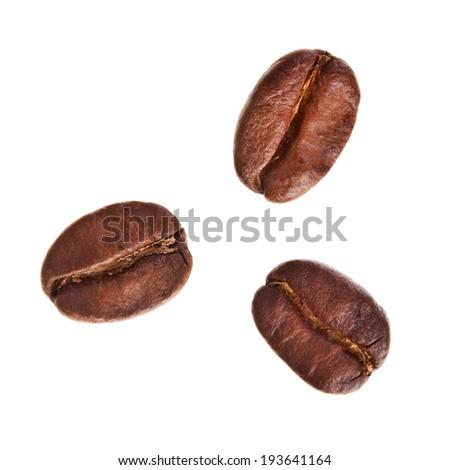 coffee beans close up macro shot isolated on white background - stock photo