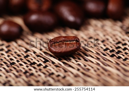 Coffee beans closeup on blurred background - stock photo