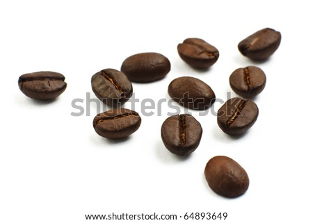 Coffee beans closeup shot isolated on white