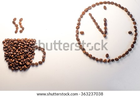 Coffee beans conventionalized to clock,mug shaped coffee beans isolated on white background,time shaped coffee beans,coffee time,horizontal photo - stock photo